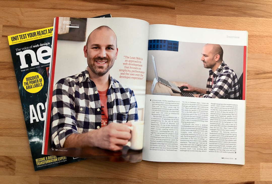 A magazine open on a desk with a picture of Chris Ferdinandi drinking a cup of coffee